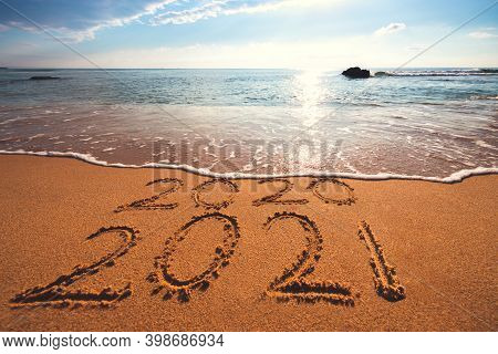 Happy New Year 2021 Concept, Lettering On The Beach. Sea Sunrise.
