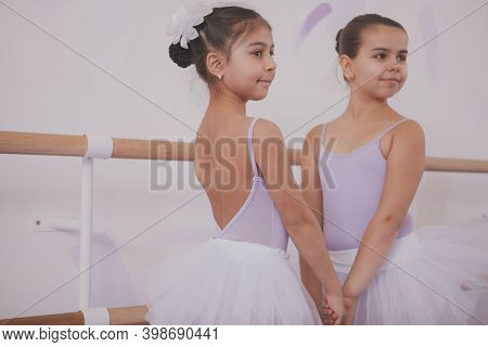 Adorbale Young Ballerinas Holding Hands, Enjoying Learning Dancing Ballet Together. Cute Little Girl