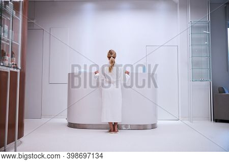 Female Patient Making Inquiries About Beauty Services