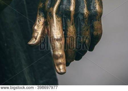 Close Up Of Bronze Statue With Hand Is Polished To A Shine For Good Luck