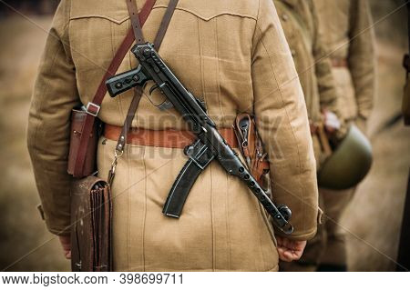 Re-enactor Dressed As Russian Soviet Infantry Soldier Of World War Ii With Sub-machine Gun Weapon. R