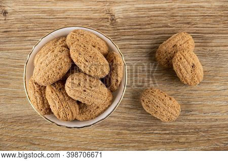 Crispy Oat Pillows With Filling In White Bowl, Few Crispy Pillows On Brown Wooden Table. Top View