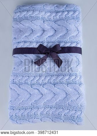Beautiful Wool Knitted Coverlet In The Pale Blue Color Made Like A Present With The Dark Blue Ribbon