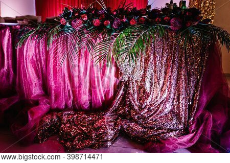 Festive Tablen Stands Decorated With Composition Of Violet, Purple, Pink Flowers And Greenery In The