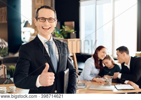 Confident Adult Man In Suit Stands In Front Of Office Of Family Lawyer And Thumb Up.