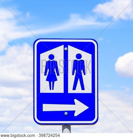 Public Toilet Sign With Arrow In Rural South Australia