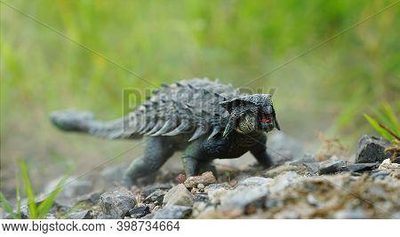 Ankyrosaurus Dinosaurs On Nature Background. Closeup Dinosaur And Monster Model. The Dinosaur From T
