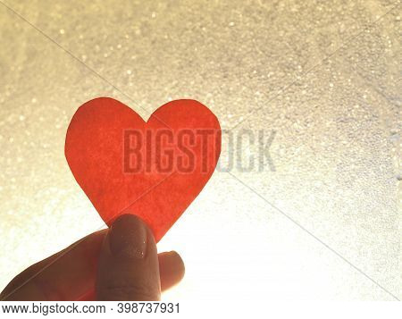 Girl Holds A Red Heart In Her Hands, Close Up. Female Hands Holding A Heart In Her Hands, Valentines