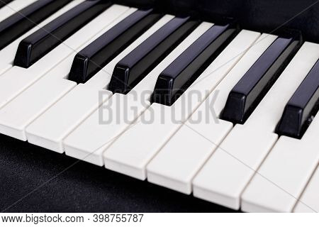 White And Black Piano Keys Close Up