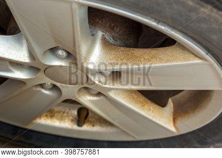 Dirt And Dust From Old Brake Pads On The Car Disk. Concept Of Faulty Brakes. Replacement Of Brake Pa