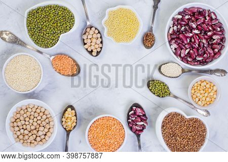 A Variety Of Cereals And Legumes On A Light Background. Lentils, Red Beans, Quinoa, Chickpeas, Munch