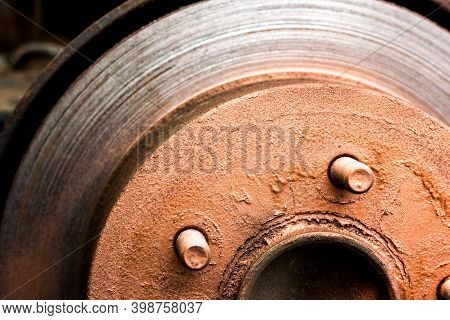 An Old Rusty Hub Without A Wheel. Brake Disc And Brake Caliper On The Car. Copper Lubrication Of Car