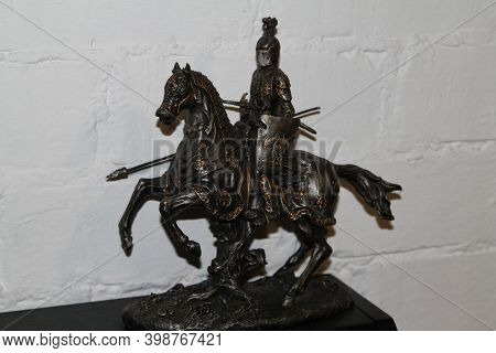 Horseman Rider Iron Statuette On The White Background
