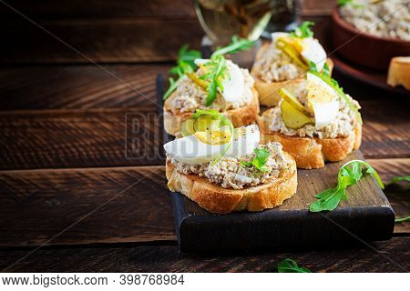 Toasted Bread With A Salted Codfish Mousse On Wooden Cutting Board. Mackerel Paste On Toasts From Fr