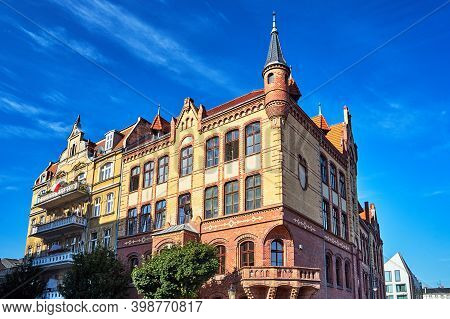 Neo-gothic Facade Of A Historic Red Brick Tenement House In Poznan