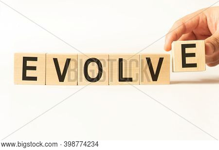 Word Evolve. Wooden Small Cubes With Letters Isolated On White Background With Copy Space Available