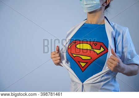 12.07.2020 Russia, Novosibirsk: Female Doctor Wearing A Medical Mask Unbuttons His Coat And Exposes