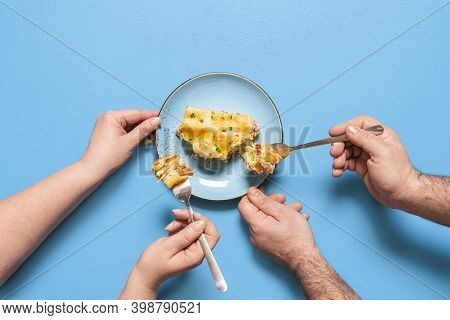 People Sharing And Eating A Slice Of Lasagna, Isolated On Blue Background. Flat Lay With Vegetable L