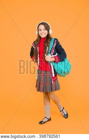 Small Girl Headset With Backpack. Kid With English Flag On Jacket. Study English Language Online. Im