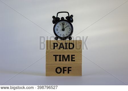 Paid Time Off Symbol. Wood Blocks With Words 'paid Time Off' On A Beautiful White Background. Black