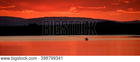 People floating canoeing on lake at sunset relaxing vacation fun