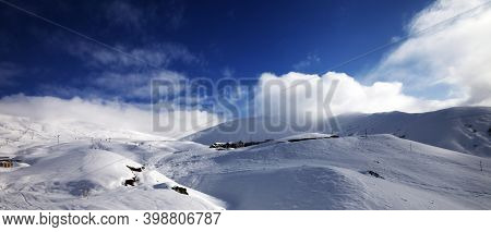 Panoramic View On Snowy Off-piste Slope On Ski Resort In High Winter Mountains At Sunny Wind Day. Ca