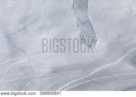 Off Piste Snowy Slope With Traces Of Skis, Snowboarding And Avalanche. High Winter Mountains.