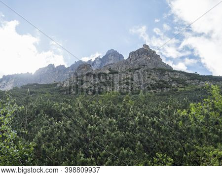 View On Limestone Moutain Peaks And Pine Tree Forest At Stubai Hohenweg, Alpine Landscape Of Tirol A