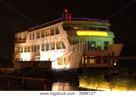 Chinese passenger's ferry by night with nice luminescence Ningbo city China. poster
