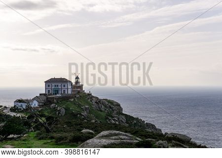 The Cape Finisterre Lighthouse On The Western Coast Of Galicia