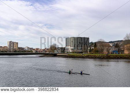 Pontevedra, Galicia / Spain - 2 December 2020: Kayakers On The Pontevedra River With The Dos Tirante