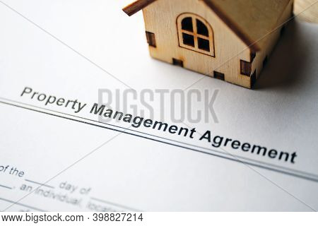 Legal Document Property Management Agreement On Paper Close Up.