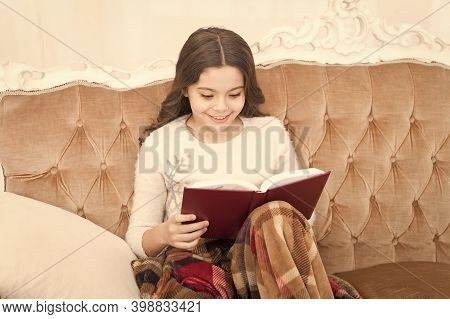 Child Reading Interesting Book. Love Winter Fairy Tale. Literature For Children. Cosy Evening At Hom