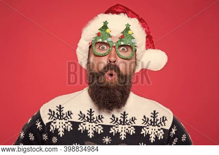 Surprised Face. Happy Bearded Man With Santa Look. Holiday Accessories For Santa Party. Christmas An