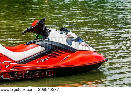 Maple Ridge, Canada - June 28, 2020: Red Jetski On The Still Waters Of Alouette Lake