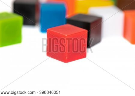 Close up shot of selective focus on red plastic block in the foreground  with other color blocks on background