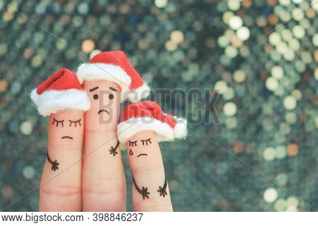 Fingers Art Of Displeased Family Celebrates Christmas. Concept Of Group Of Sad People In New Year Ha