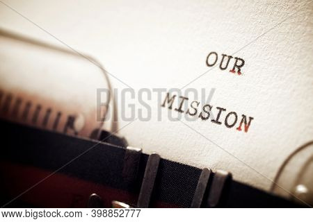 Our mission phrase written with a typewriter.