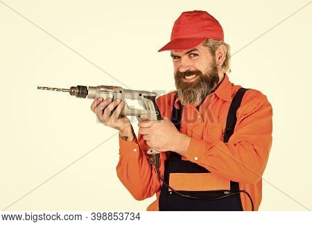 For Drilling Solid Wall You Need Masonry Bit. Man In Cap With Drills White Background. Perforator An