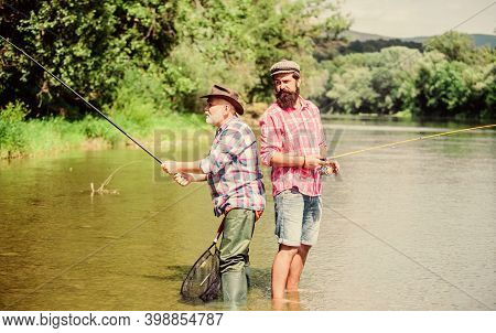 Father And Son Fishing. Fisherman Family. Hobby Sport Activity. Summer Weekend. Peaceful Activity. N