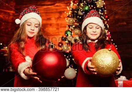 Santa Claus Little Girls Sisters. Little Girl Sisters In Red Hats. Wait For Santa Claus. Christmas T