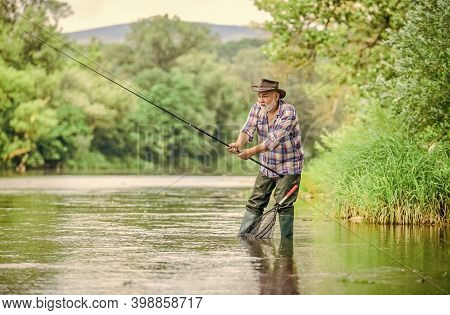 Summer Weekend. Big Game Fishing. Man Fly Fishing. Man Catching Fish. Hobby And Sport Activity. Poth