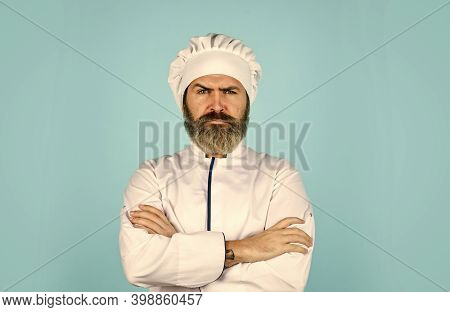 Cook Chef In White Uniform. Bearded Man Chef. Bearded Man Restaurant Worker. Professional Cook. Culi