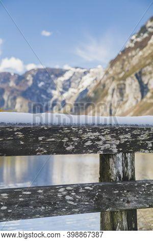 A Railing Covered With Snow. Lake Bohinj, Slovenia