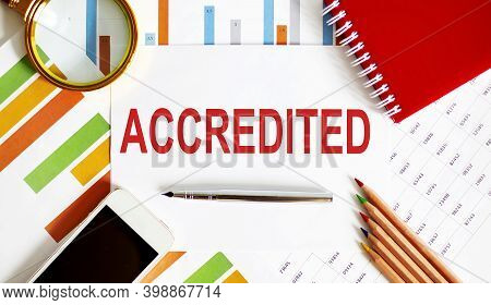 Word Writing Text Accredited On Notepad. Business Concept With Office Tools On Chart Background