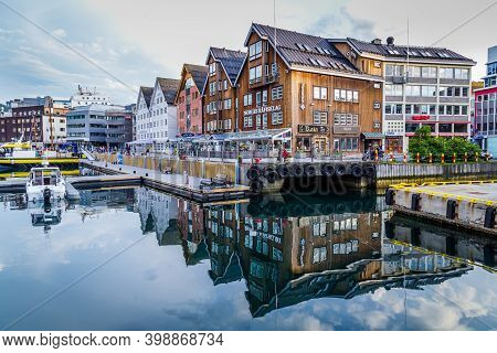 Tromso, Finland - July 26, 2016: Harbor With Old Warehosues In The Center Of Tromso In Northern Norw