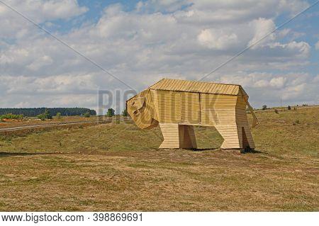 Kamenka, Lipetsk Oblast, Russia - August 07, 2020: Wooden Bull As Art Object On