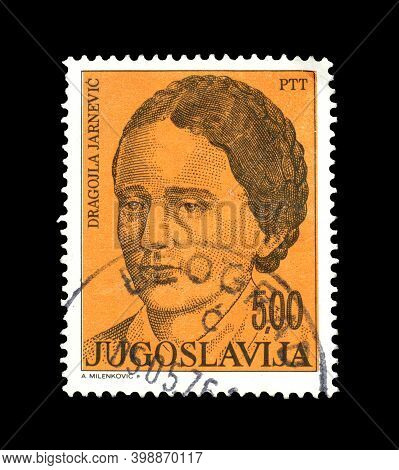 Yugoslavia - Circa 1976 : Cancelled Postage Stamp Printed By Yugoslavia, That Shows Poet And Teacher