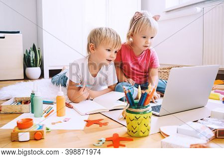 Kids Using Computer Online Technology To Art Creative, Drawing Or Making Crafts.