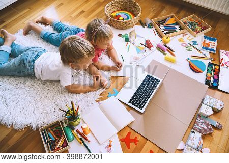 Kids Drawing And Making Crafts With Online Art Classes At Home. Children Using Laptop To Distance On